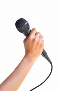 Holding-a-microphone-199x300